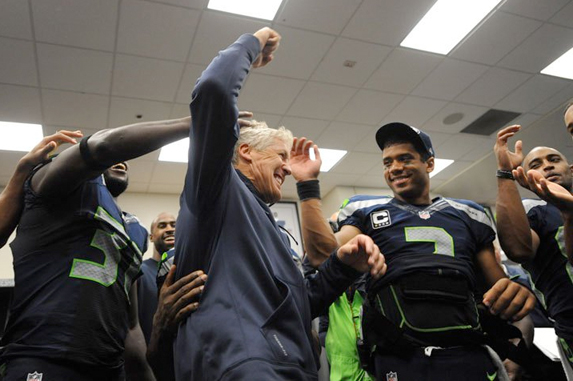 Pete Carroll informs the team that D.T. is not only going to be at the game, but has picked them to win.